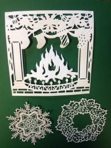Gestanste vormen openhaard , sneeuwvlok en kerst krans